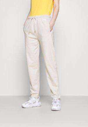 NABEMONO - Teplákové kalhoty - natural