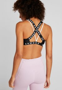 Under Armour - WORDMARK STRAPPY SPORTLETTE - Soutien-gorge de sport - black/white - 2