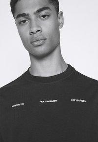 Holzweiler - RANGER TEE - Print T-shirt - black - 3