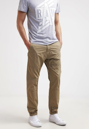 MARSHALL COLUMBIA - Pantalones - leather rinsed