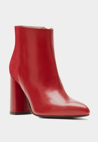PoiLei - High heeled ankle boots - red - 1