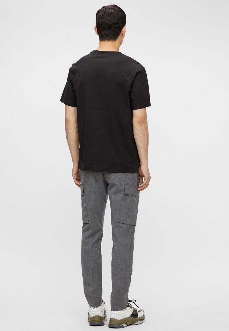 J.LINDEBERG JORDAN - T-Shirt print - black/schwarz - Herrenbekleidung MgJsE
