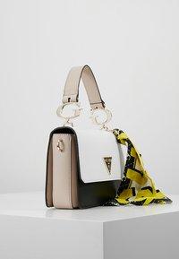 Guess - ANALISE CROSSBODY FLAP - Handbag - white - 3