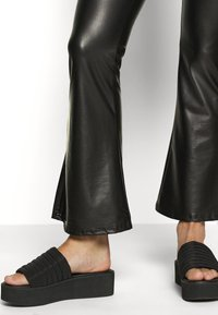 ONLY - ONLCOOL FLARED - Trousers - black - 4