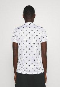 Nike Golf - Sports shirt - white/black - 2