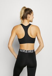 Nike Performance - BAND BRA NON PAD - Urheiluliivit - black/white - 2