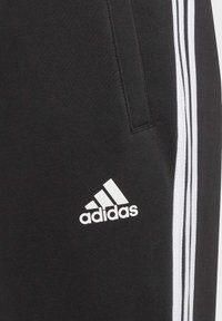 adidas Performance - 3 STRIPES ATHLETICS SPORTS REGULAR PANTS - Spodnie treningowe - black - 6