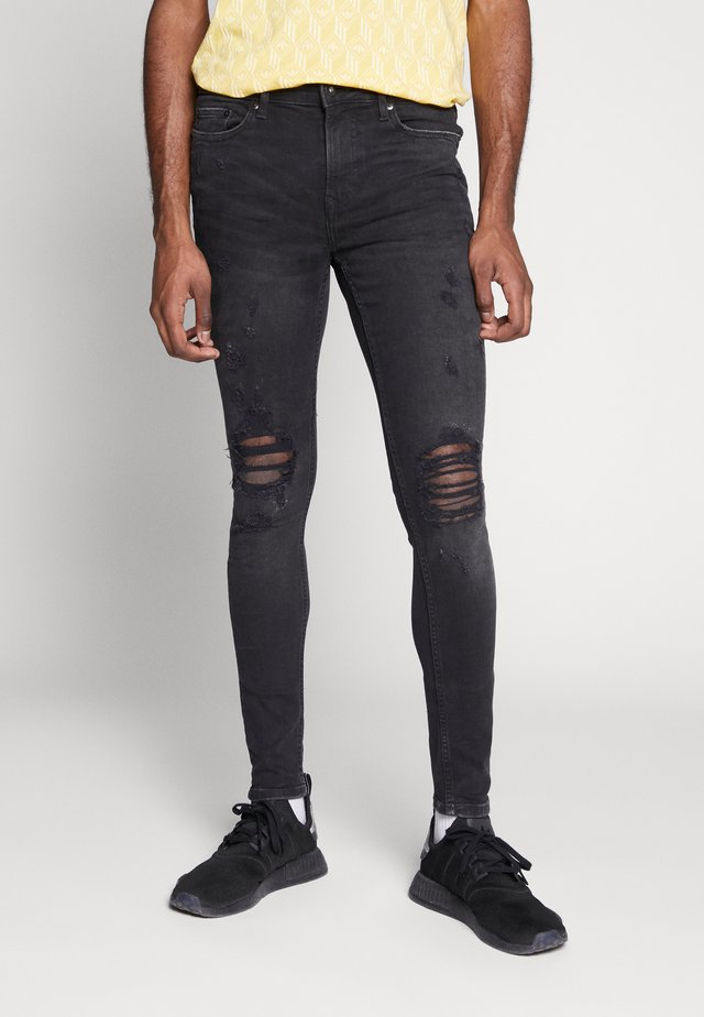 LADDER KNEE - Jeans Skinny Fit - black denim