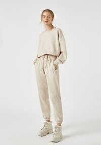 PULL&BEAR - Tracksuit bottoms - beige - 1