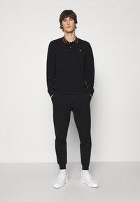 Vivienne Westwood - CLASSIC - Tracksuit bottoms - black - 1