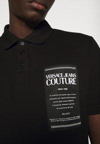 Versace Jeans Couture - PLAIN - Polo shirt - black - 4