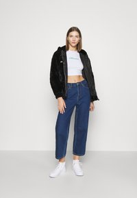 Ellesse - GIOVANNA - Summer jacket - black - 1