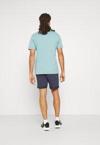 Fila - NOLAN SHORTS CROPPED - Sports shorts - black iris - 2