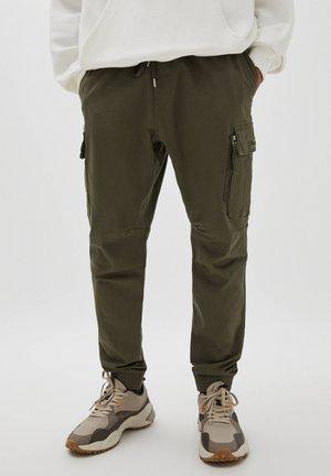 PREMIUM - Pantaloni sportivi - dark green