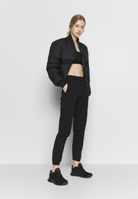 Champion Rochester - ELASTIC CUFF PANTS - Pantalones deportivos - black - 1