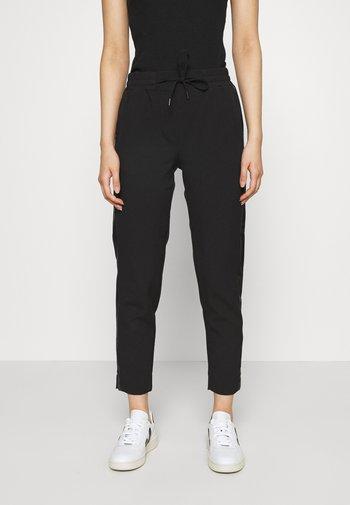 SAYA - Trousers - black