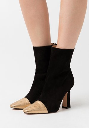 High heeled ankle boots - nero/metal oro