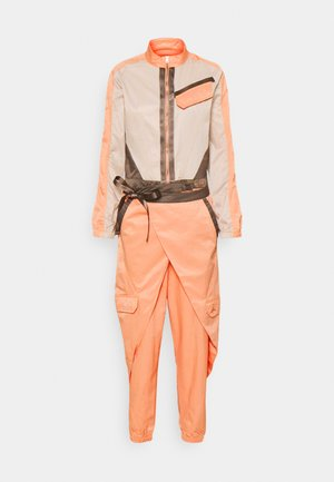 FLIGHTSUIT FUTURE - Tuta jumpsuit - apricot agate/red/bronze
