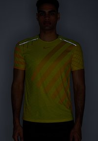 Nike Performance - TECH COOL  - Print T-shirt - volt/dark sulfur/reflective silver - 4