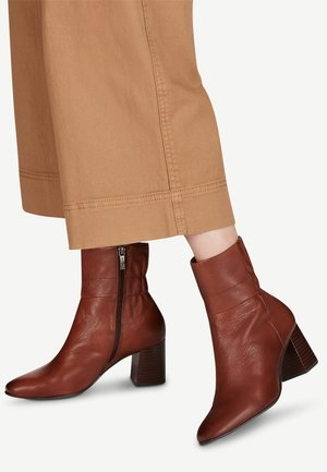STIEFELETTE - Ankle boots - brandy