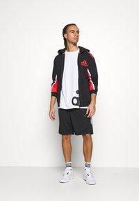 adidas Performance - HOODIE - Zip-up hoodie - black/red - 1