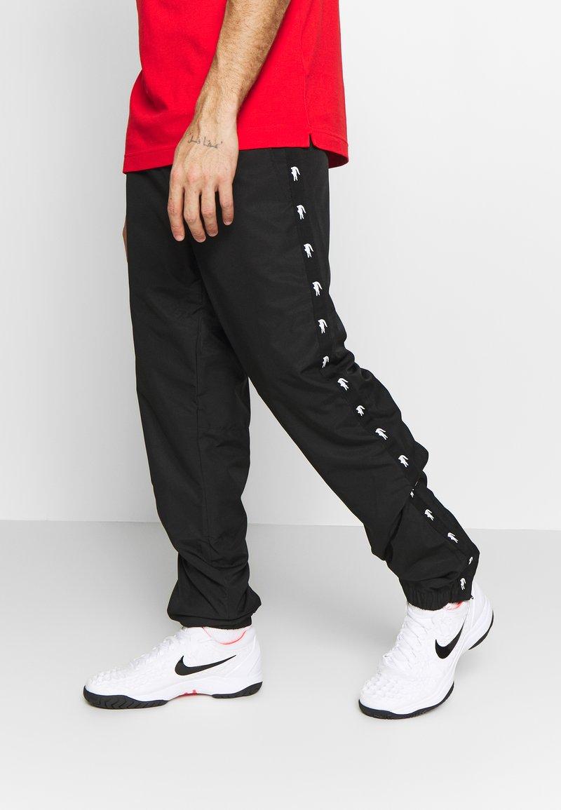 Lacoste Sport - TENNIS PANT TAPERED - Spodnie treningowe - black
