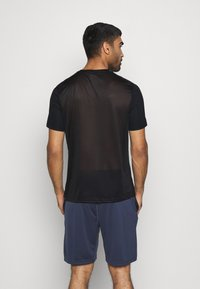 Reebok - TECH TEE - Print T-shirt - black - 2