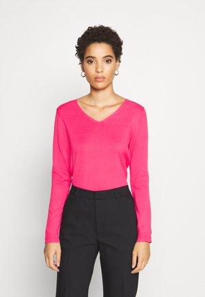 Strikkegenser - pink fuchsia