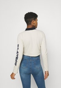 Missguided - PLAYBOY VARSITY CROP - Polo shirt - stone - 2