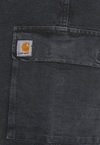 Carhartt WIP - KEYTO PANT DEARBORN - Cargo trousers - black - 2