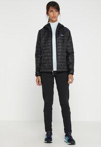Patagonia - NANO PUFF HOODY - Outdoor jacket - black - 1