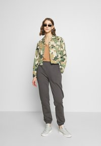 Nly by Nelly - COZY PANTS - Tracksuit bottoms - off black - 1
