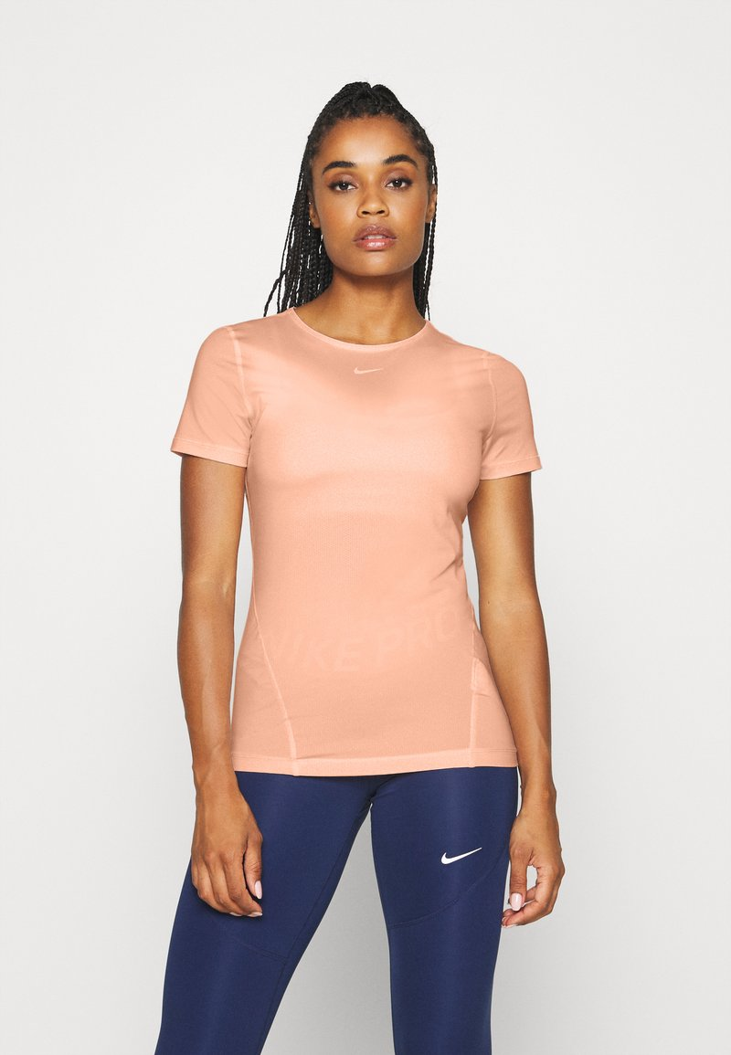 Nike Performance - ALL OVER - Basic T-shirt - washed coral