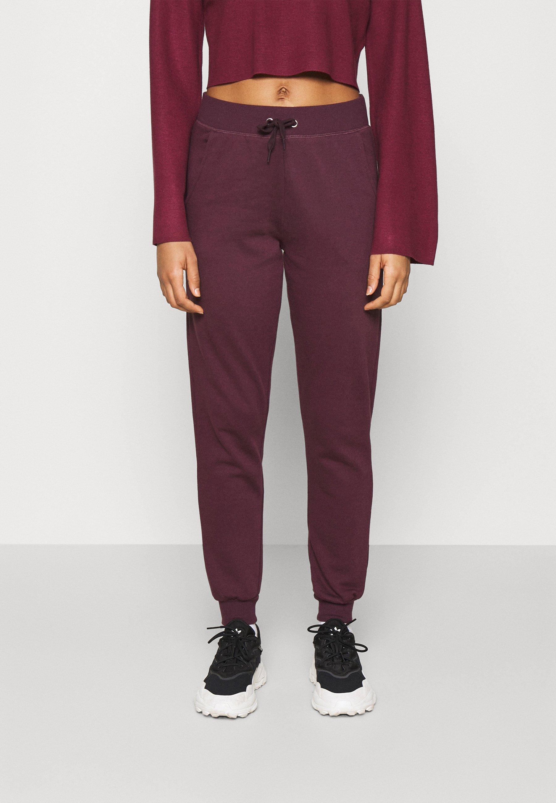 Women SLIM LEG JOGGER - Tracksuit bottoms - dark burgundy