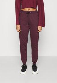New Look - SLIM LEG JOGGER - Tracksuit bottoms - dark burgundy - 0