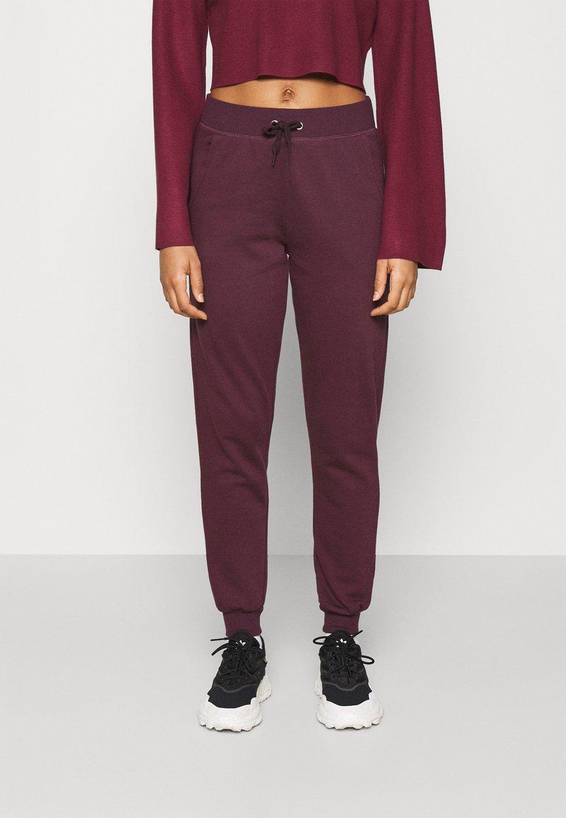 New Look - SLIM LEG JOGGER - Tracksuit bottoms - dark burgundy