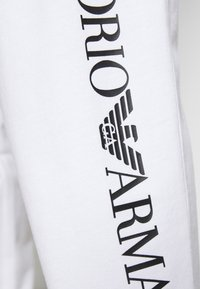EA7 Emporio Armani - Tracksuit bottoms - white/black - 6
