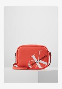 CAMERA BAG - Across body bag - orange