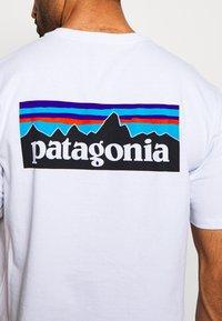 Patagonia - LOGO RESPONSIBILI TEE - Print T-shirt - white - 5
