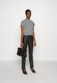 Freaky Nation - PANTS - Leather trousers - black - 1