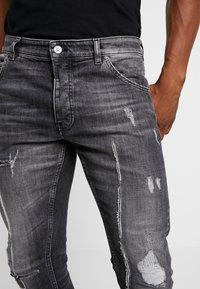 Tigha - BILLY THE KID - Slim fit jeans - mid grey - 3