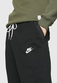 Nike Sportswear - Tracksuit bottoms - black/ice silver/white - 4