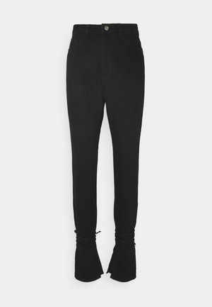 RIOT HIGHWAISTED TIE HEM MOM - Bootcut jeans - black