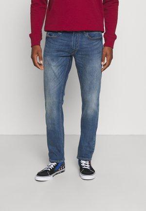 RIDGE - Straight leg jeans - blue