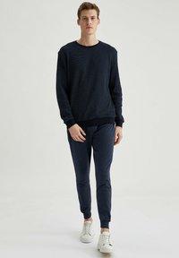 DeFacto - Pantaloni sportivi - indigo - 1