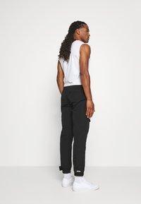 WRSTBHVR - TROUSER HYDRO UNISEX - Cargo trousers - black - 2
