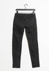 Marc O'Polo - Cargo trousers - black - 1