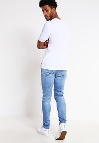 Cayler & Sons - Jeans fuselé - distressed light blue/white - 2