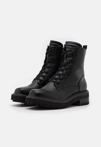 Buffalo - QUANDA - Lace-up ankle boots - black - 1