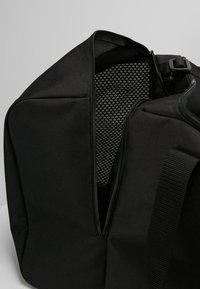 adidas Performance - TIRO DU  - Sports bag - black/white - 5